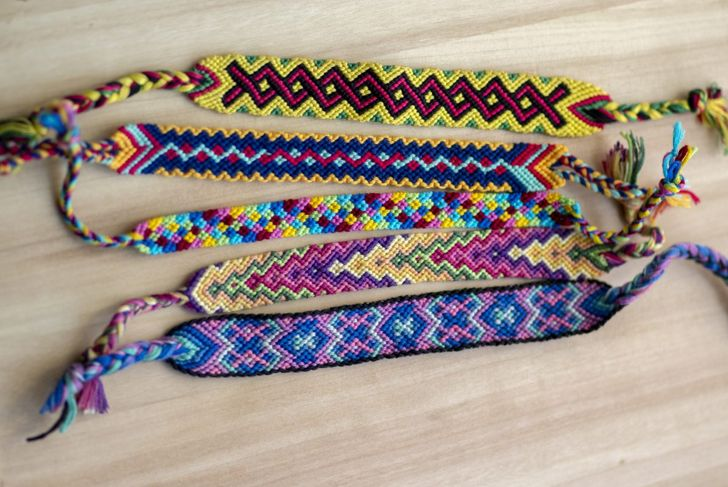 Friendship bracelets made with colorful knotted thread