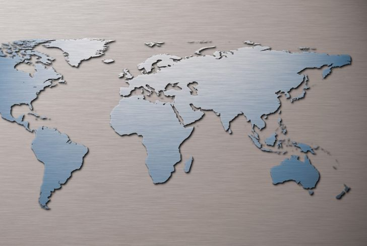 Metal world map on a wall