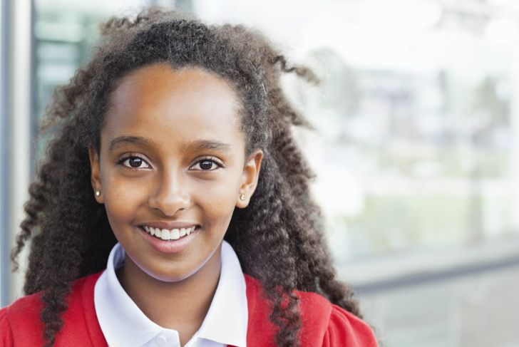 Young girl with half-up-half-down hairstyle