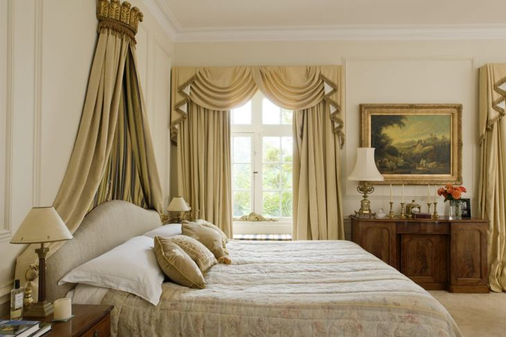 White bedroom with golden drapes