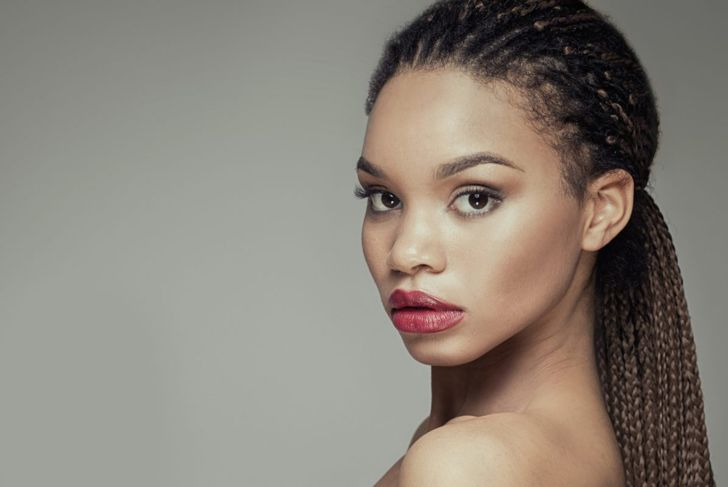 A female with her braids pulled back into a ponytail