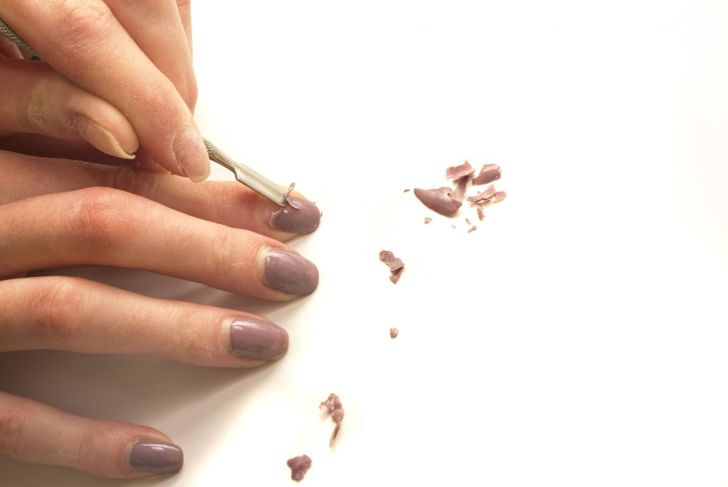 Remove acrylic nails from nail bed