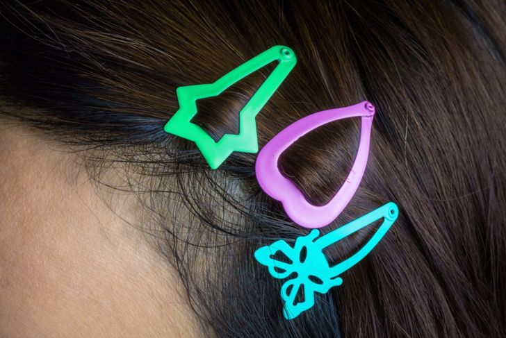 A close-up of three barrettes clipped into hair
