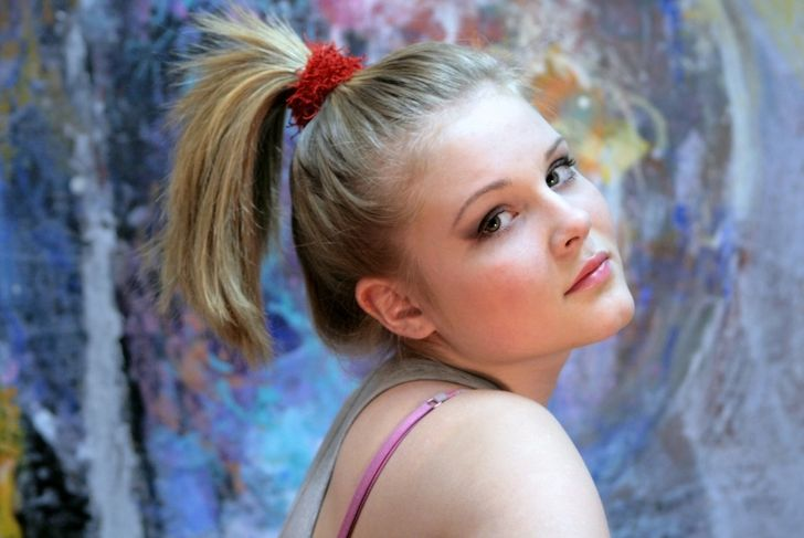 Portrait of a natural blonde. Teen Girl with a High Ponytail