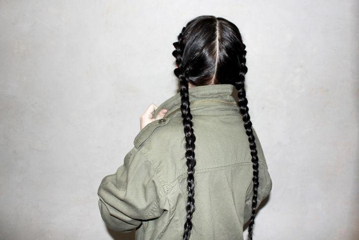 Brunette girl with french braids on dark brown hair.