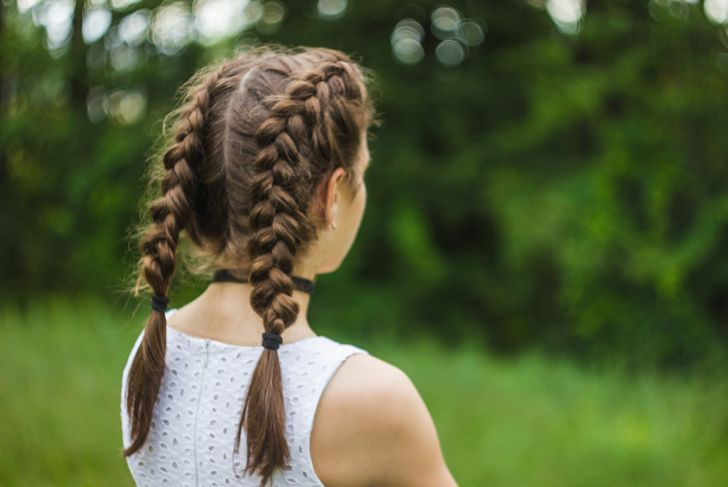 Hairstyle French pigtails on the girl