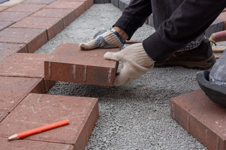 laying paver flooring brick