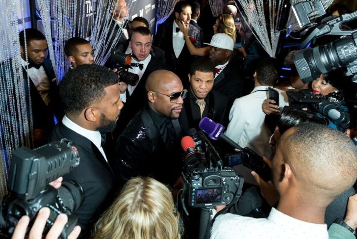 Boxer Floyd Mayweather with press