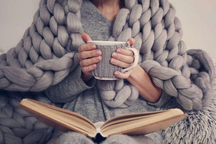 Woman with a cozy blanket