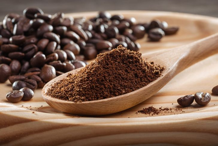 Coffee grounds in spoon