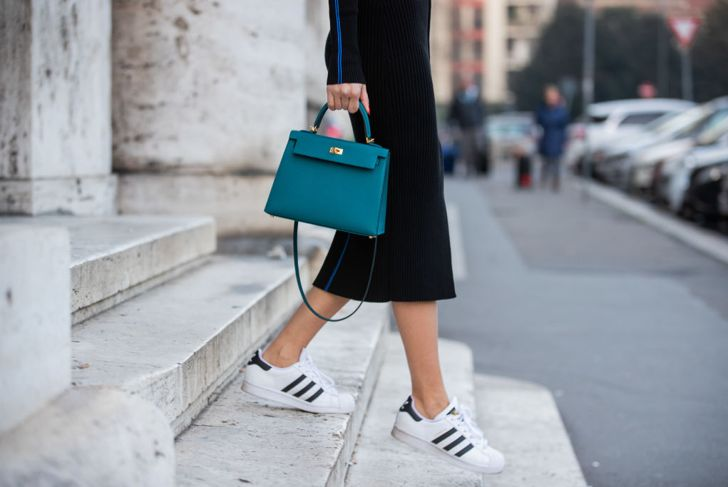 MILAN, ITALY - FEBRUARY 22: Lisa Hahnbueck is seen wearing Victoria Beckham knitted dress, Adidas superstar sneaker, Hermes Kelly bag 25 during Milan Fashion Week Fall/Winter 2020-2021 on February 22, 2020 in Milan, Italy.