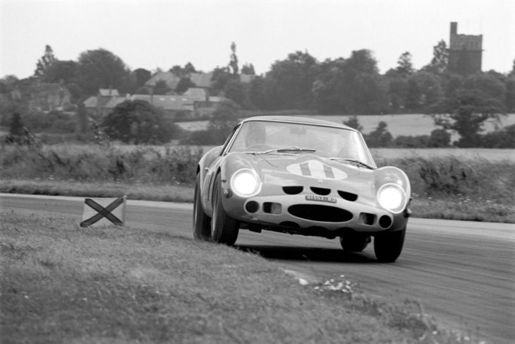 The R.A.C. Tourist Trophy; Goodwood, August 24, 1963. Graham Hill in the Ferrari 250GTO through Fordwater. A really fantastic photograph.