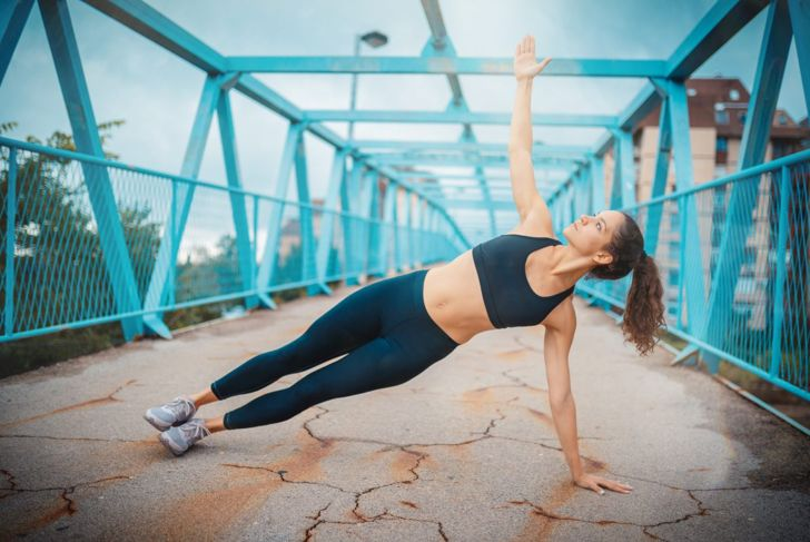 Woman in side plank pose