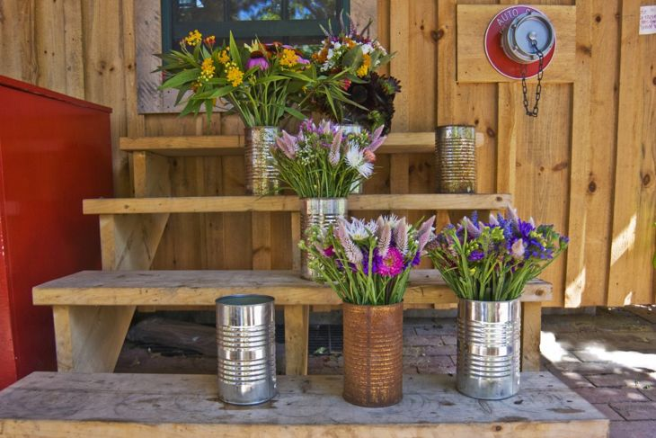 Attach tin cans to fence