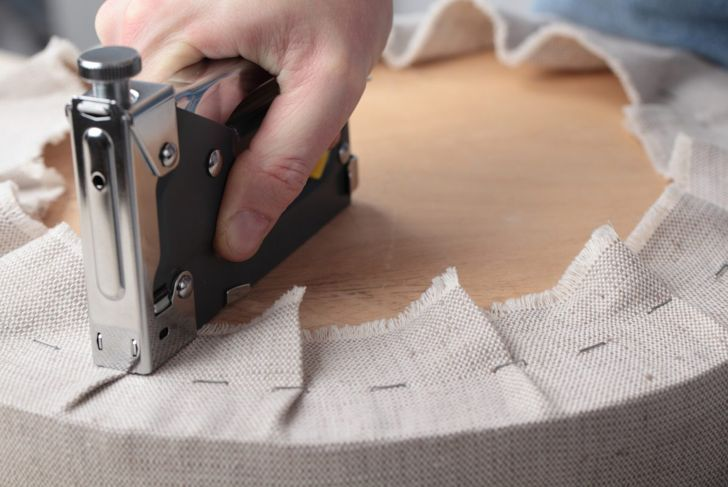 Pull fabric tight and staple