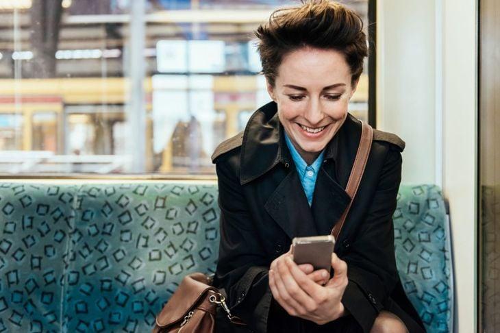 woman, phone, train, smiling
