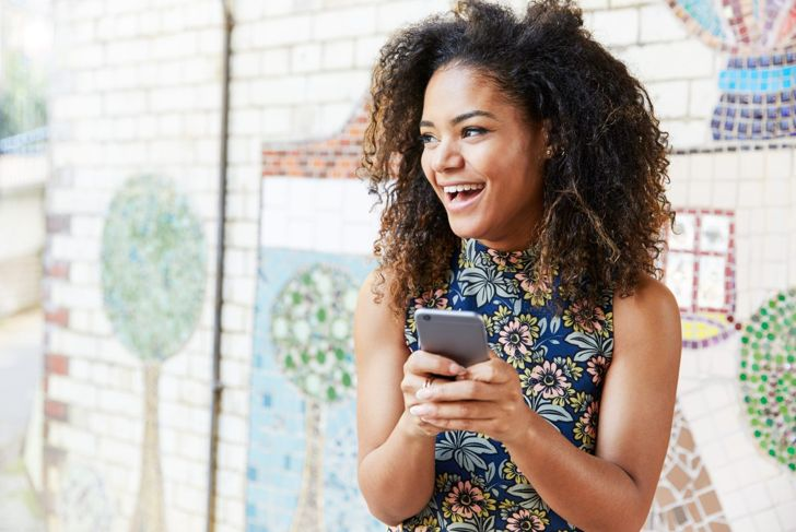 happy woman with text message