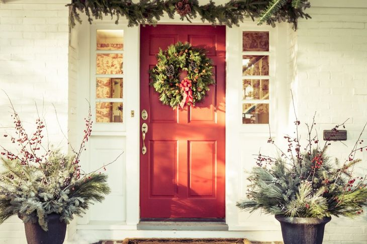 Red door with seasonal decorations