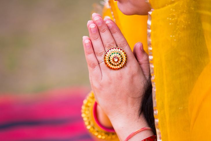 lose up Indian woman hand doing Namaste