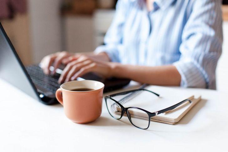 remote work typing on laptop