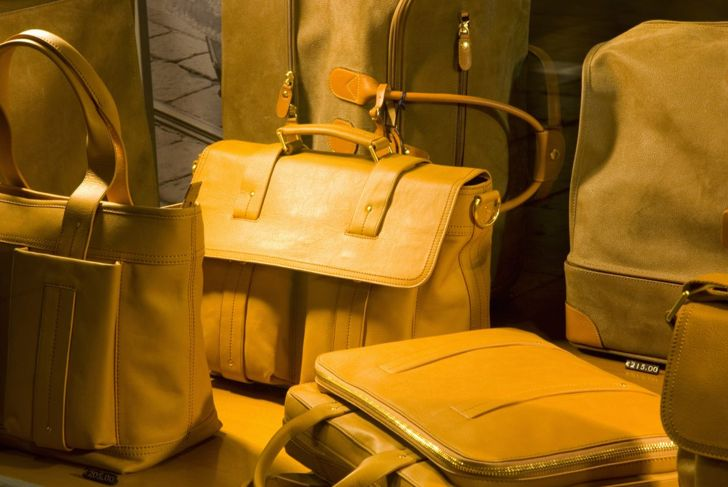close-up of yellow leather bags