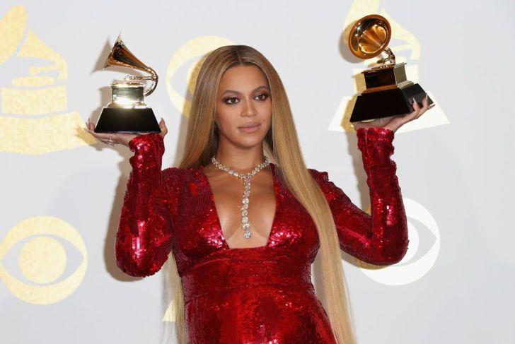 Beyoncé holding two Grammy awards