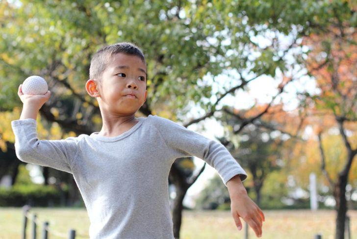boy throwing ball