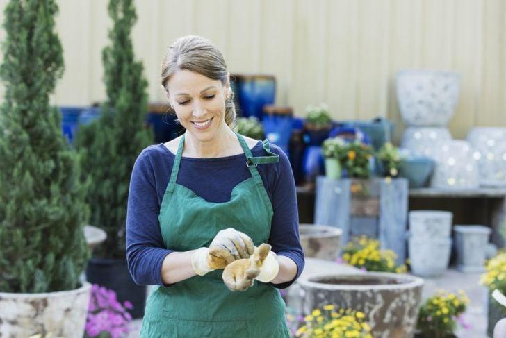 putting on gardening gloves