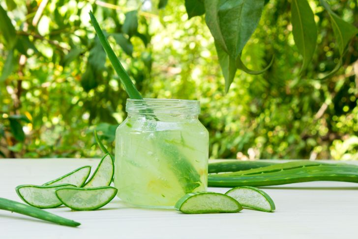 Aloe vera transparent essence with fresh leaves.
