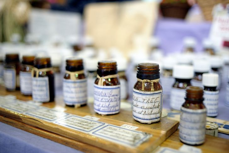 A row of open jars of essential oils at the Provencal Market, le Petit Marche Provencal, Antibes, France. Smells good!