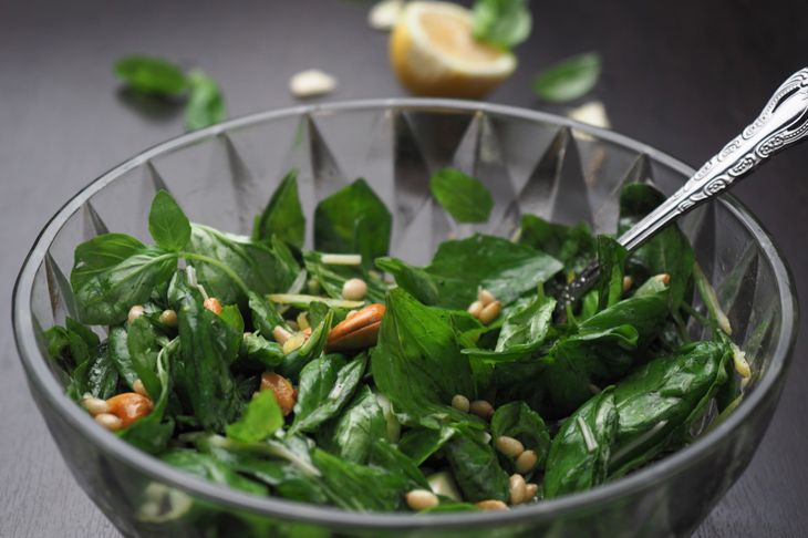 Pickled basil leaves for pesto. Basil leaves are mixed with cashew, garlic, pine nuts, cheese, lemon and olive oil.