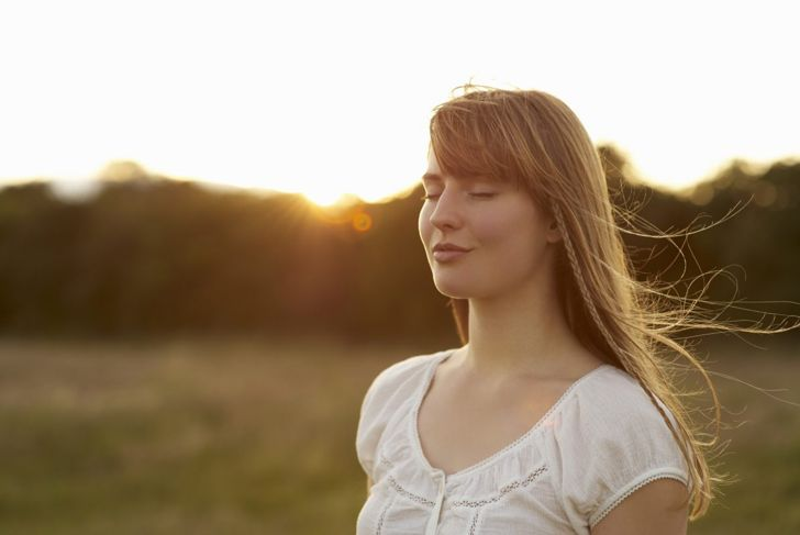 Woman thinking meditating with eyes closed