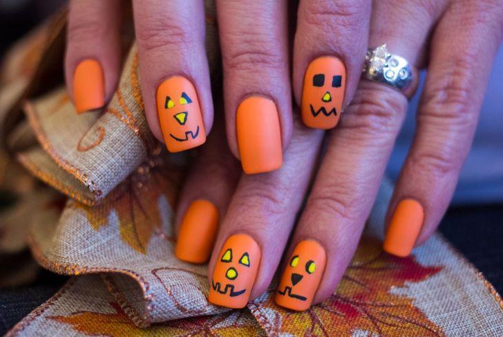 Halloween nails pumpkin face art