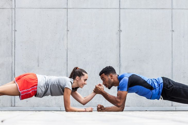 Woman and man working out together