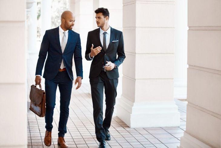 Men's attire is business professional