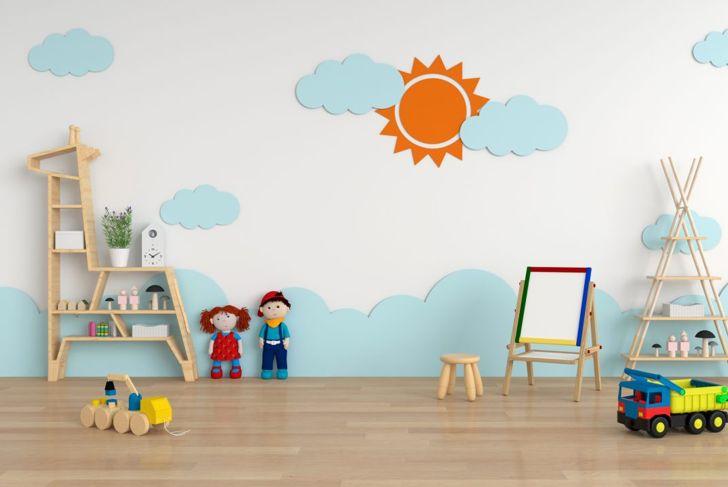 A playroom with a sky scene on the wall