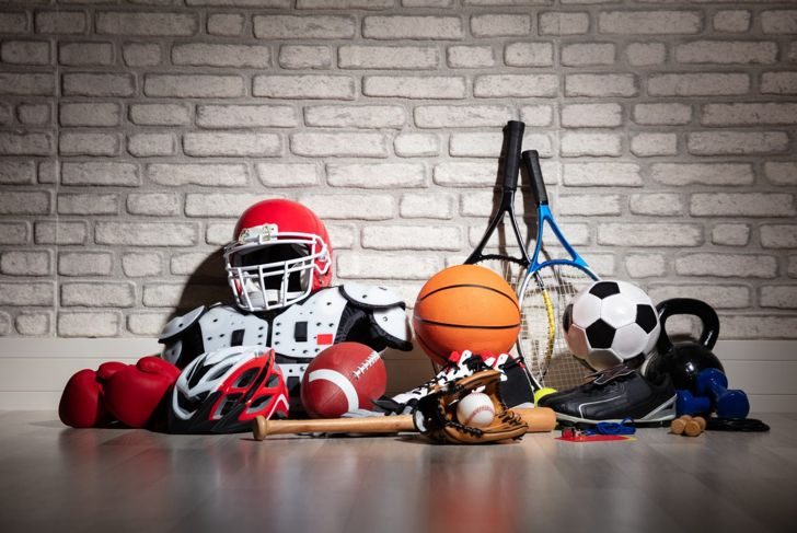 A pile of various sports equipment