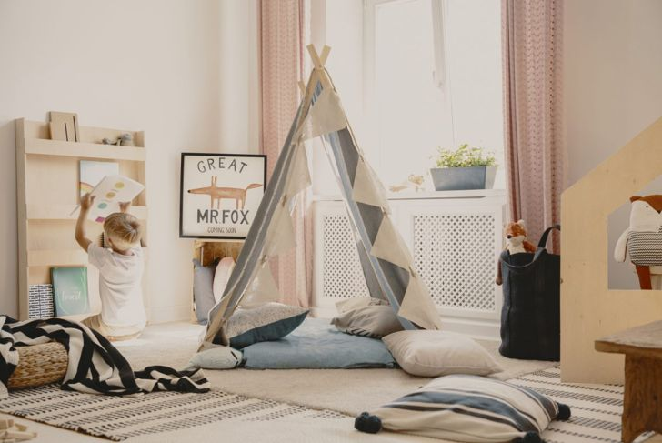 A playroom with a child's tent