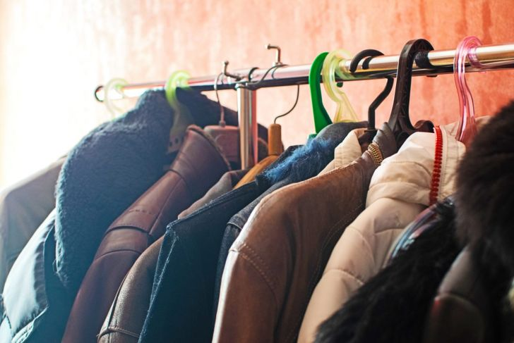 A clothing rack with several coats hanging on it