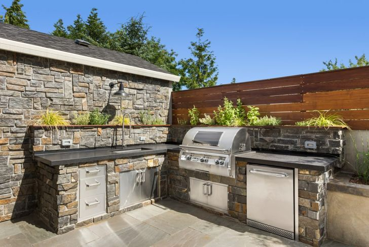 Outdoor kitchen with steel appliances