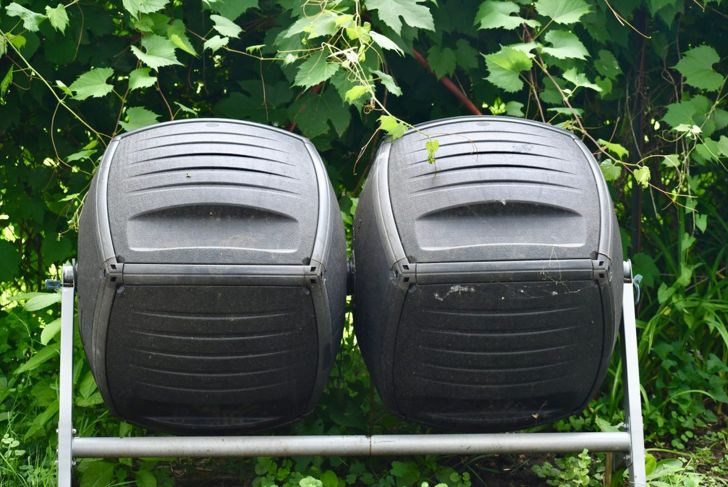 Tumbler composters outside.