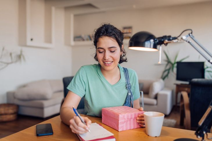 Woman creating a care package