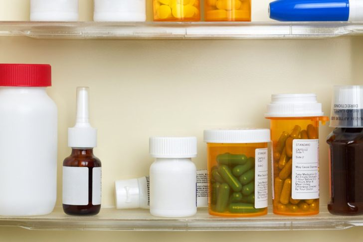A medicine cabinet with various bottles