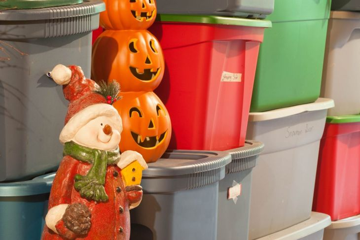 Holiday decorations in storage bins