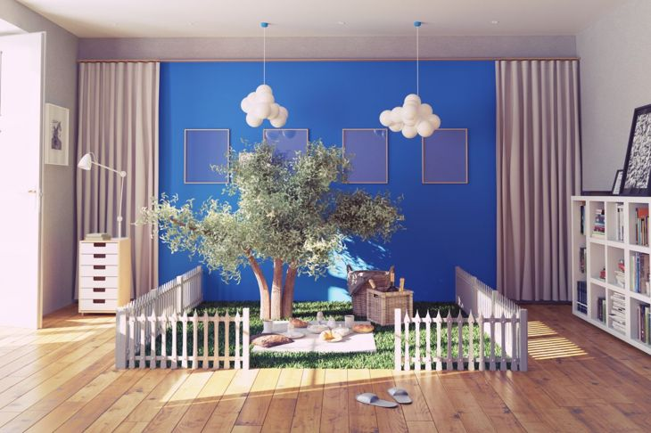 A playroom with an artificial tree and picnic area