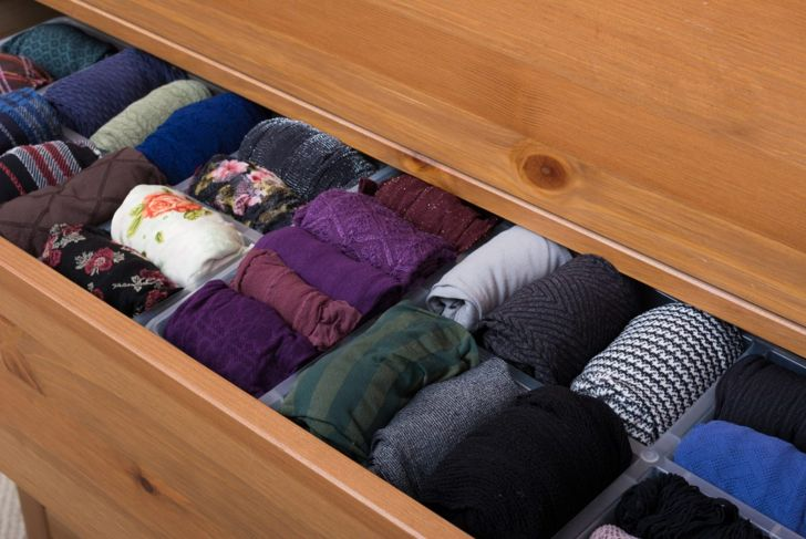 Rolled clothes in closet drawers
