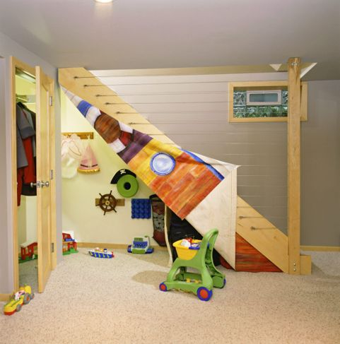 A playroom created in a space under a stairwell