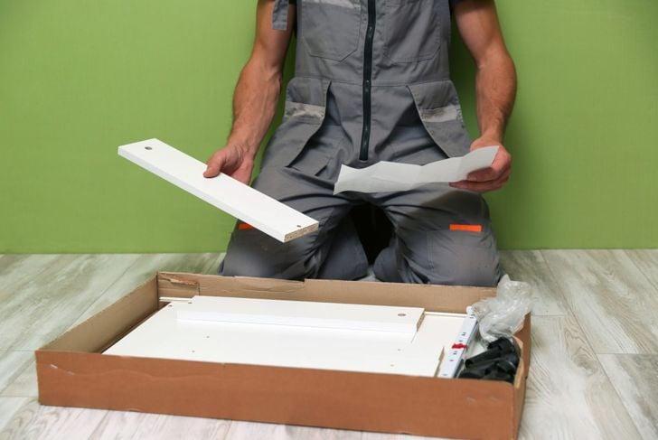 Man opening box before installation