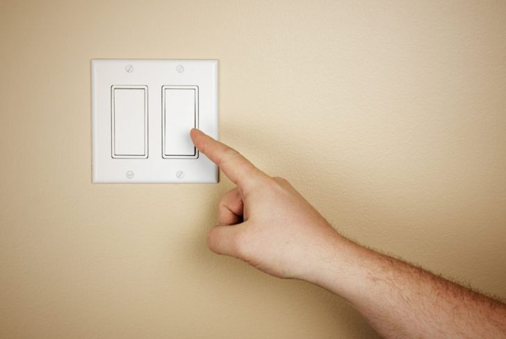 Hand on switchplate