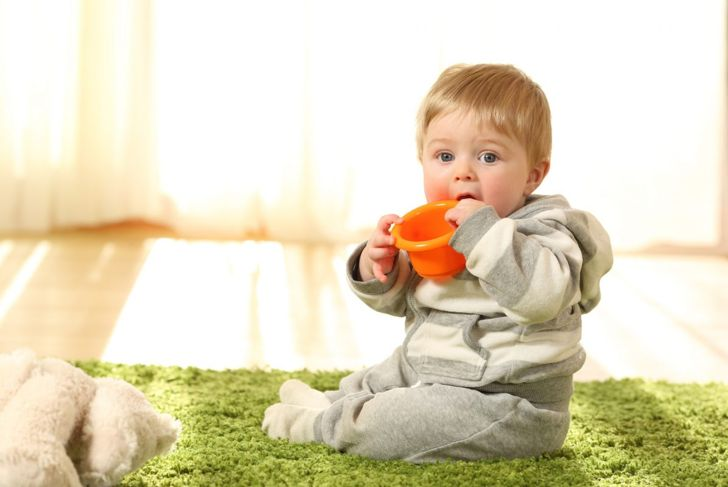 Small child with toy in mouth
